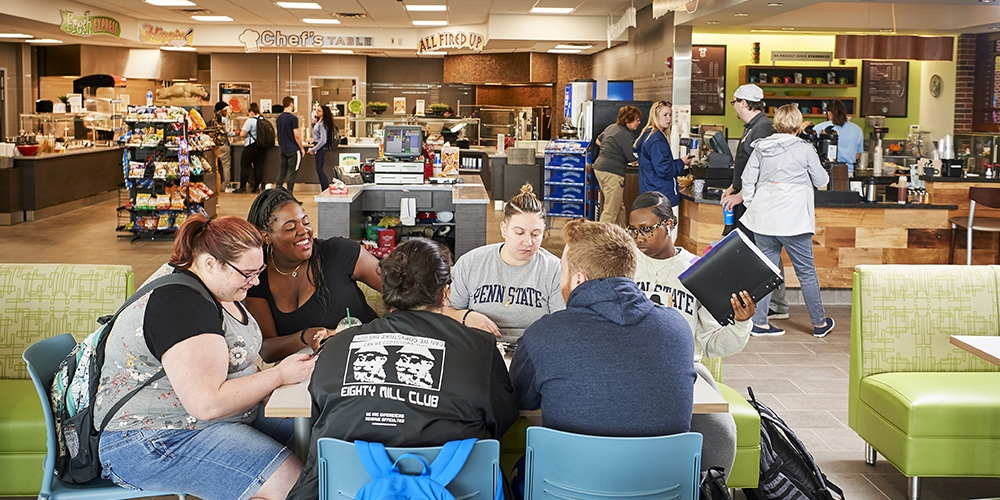 students hanging out in the Hidden Stream dining area